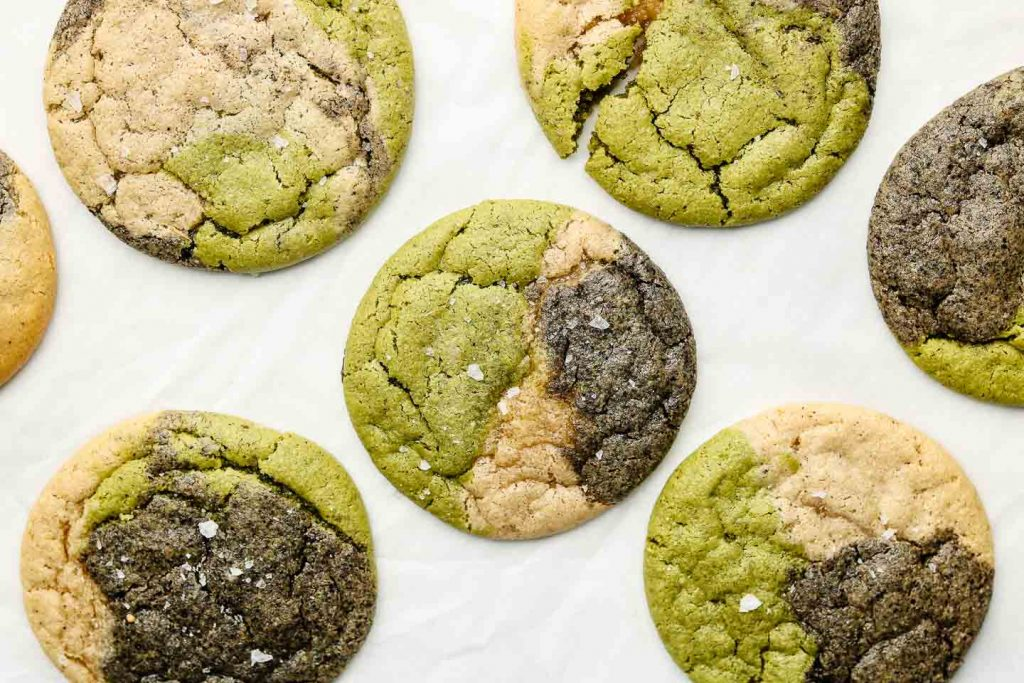 matcha black sesame marble cookies on white parchment paper landscapephoto