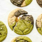 marble matcha black sesame sugar cookie half broken on parchment paper