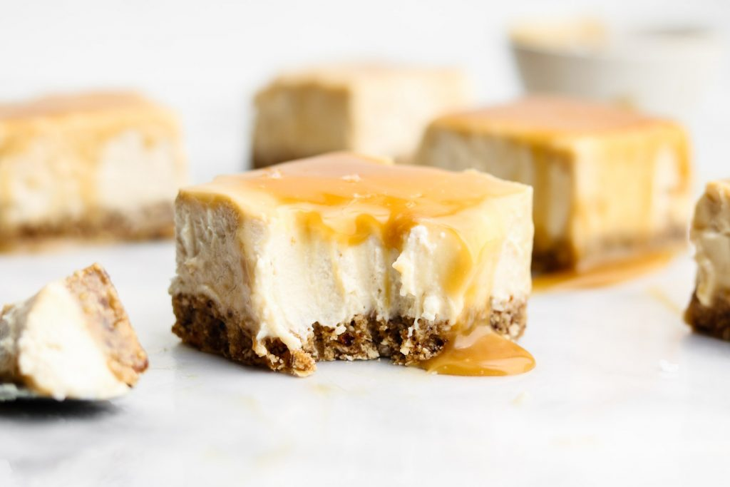 no bake salted caramel cheesecake square with a bite taken out of it