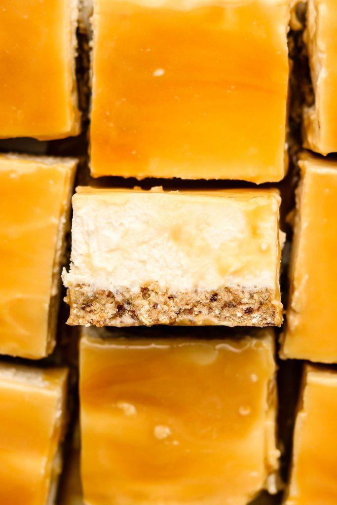 close up shot of no bake caramel cheesecake bars