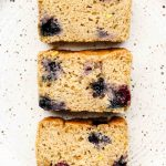 lemon blueberry loaf cake on a speckled white plate