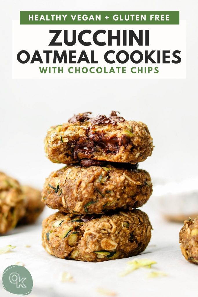 stack of zucchini oatmeal cookies with chocolate chips and a bite taken out of the top cookie