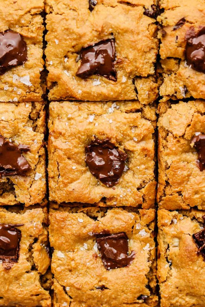 close up shot of peanut butter oatmeal bars that is cut into 9 squares topped with maldon salt