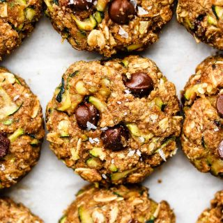 healthy zucchini oatmeal cookies with chocolate chips and flaky sea salt on top