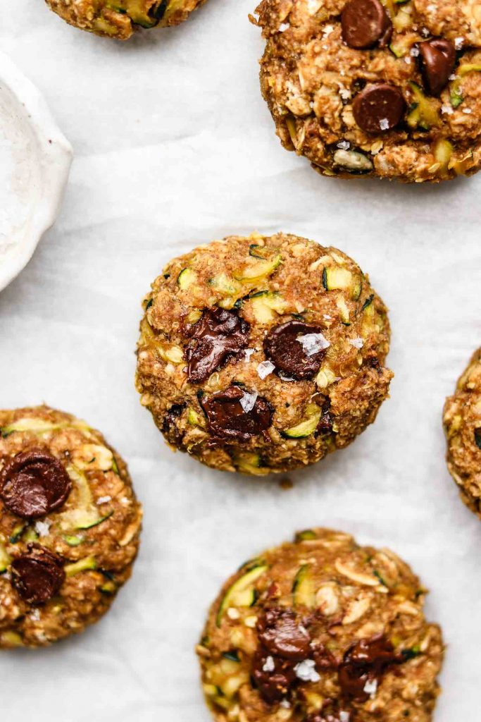 gluten free eggless zucchini oatmeal cookies on parchment paper