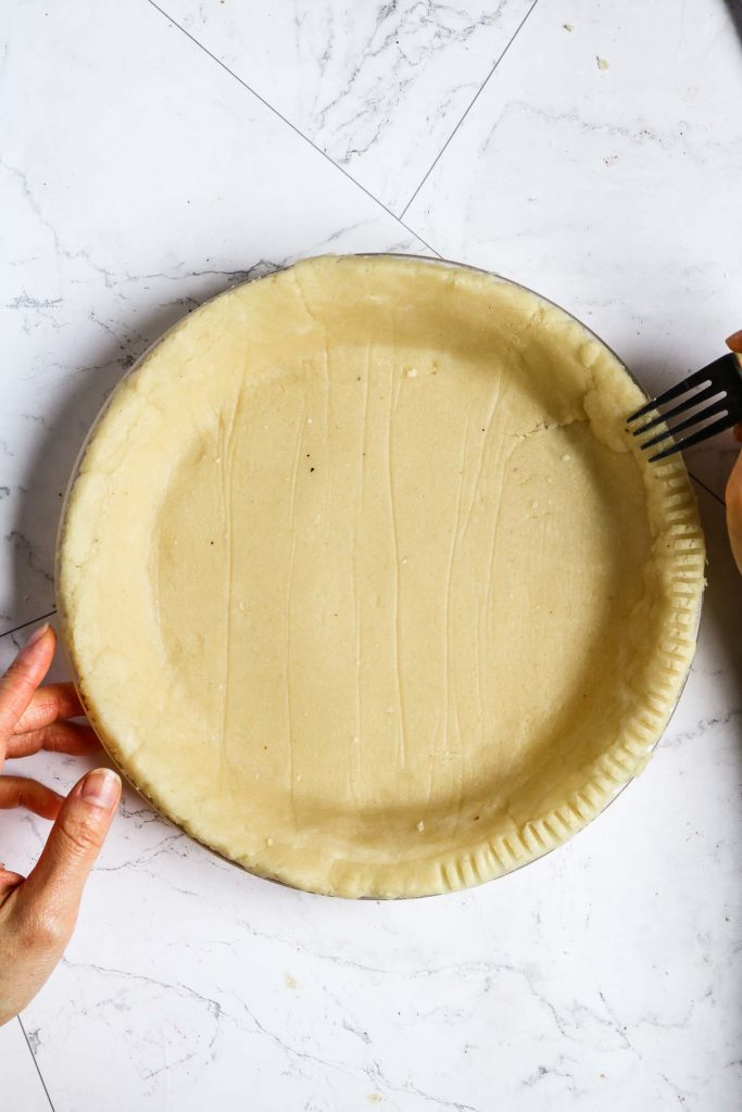 crimping healthy pie crust with a fork