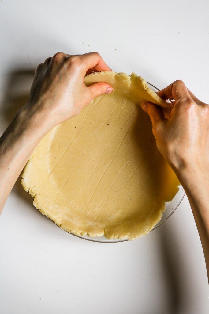 fixing pie crust edges with hands