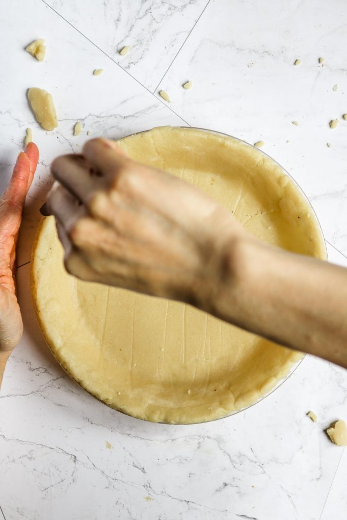 cutting pie crust edges with a knife
