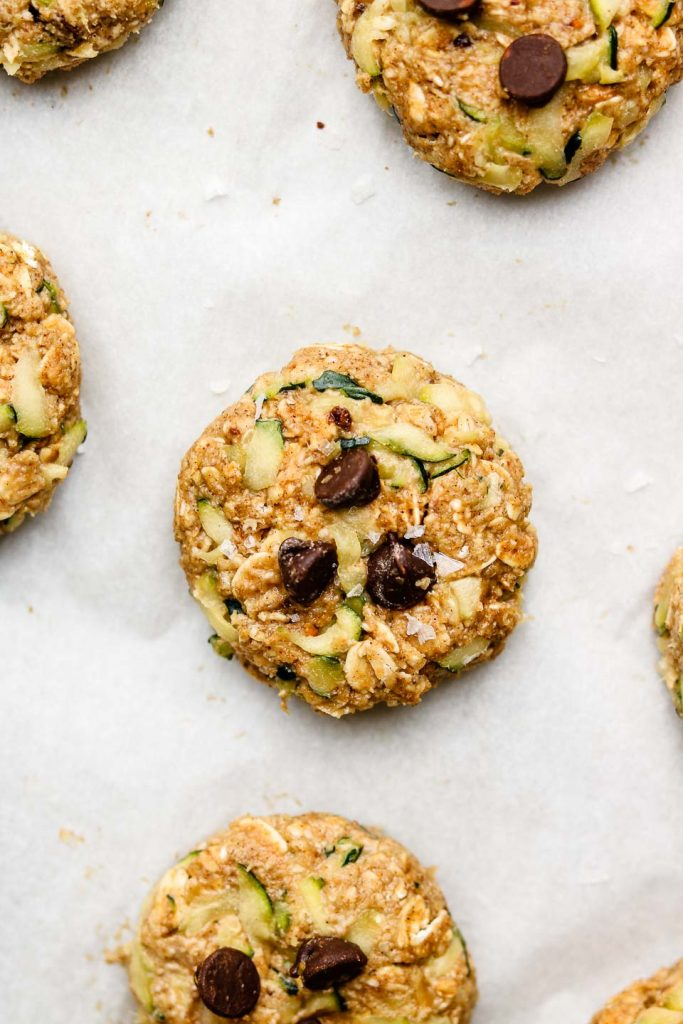 healthy zucchini cookies with chocolate chips before baking on parchment papaer