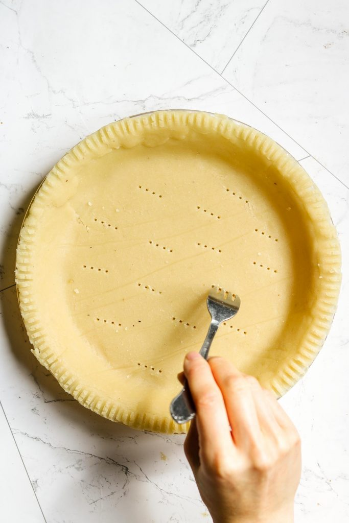 poking healthy pie crust with a fork