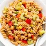 close up shot of bbq pasta salad with celery, bell peppers, corn and chickpeas