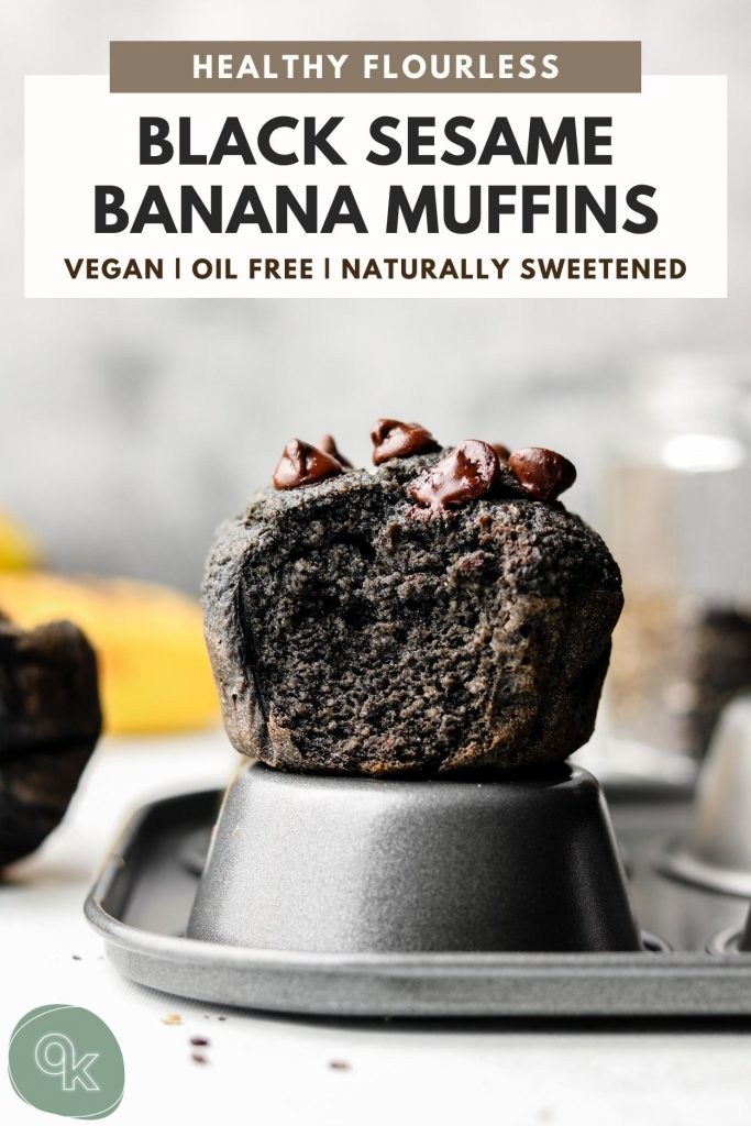 black tahini oatmeal muffins with on a muffin tin with a bite taken out of it
