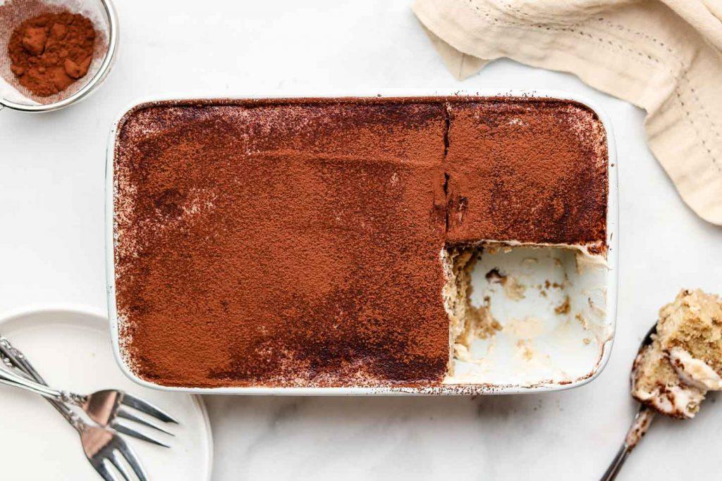 vegan tiramisu in a blue loaf pan