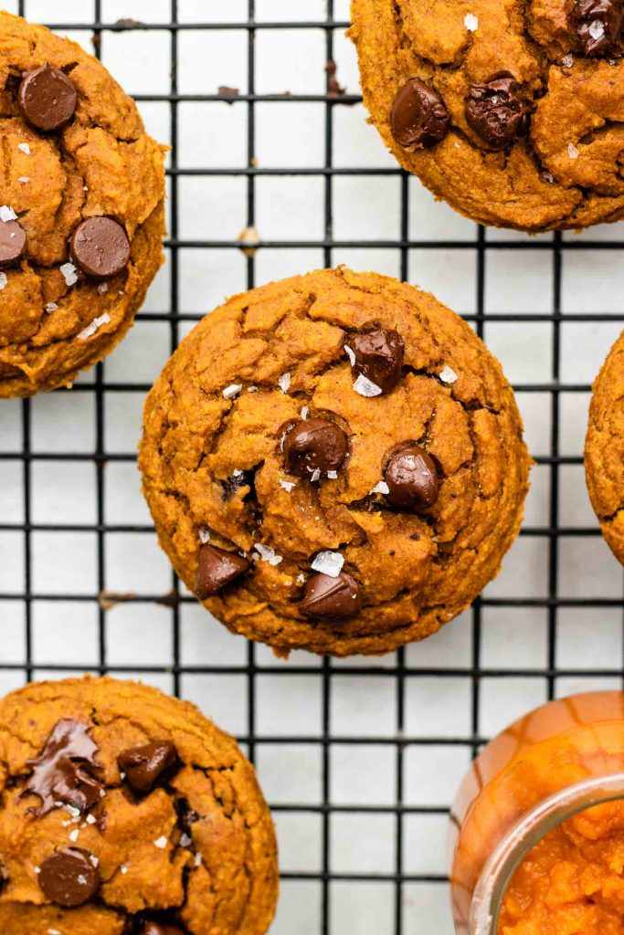 chocolate chip pumpkin muffins on a cooling rack