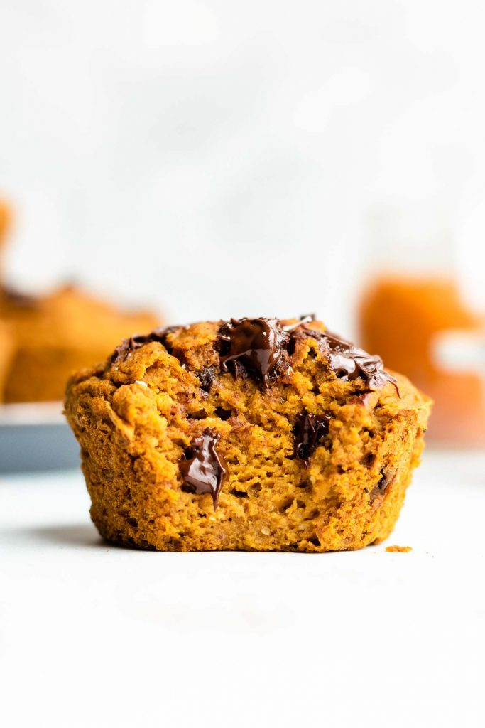 heathy flourless pumpkin muffins with chocolate chips, bite taken out of it