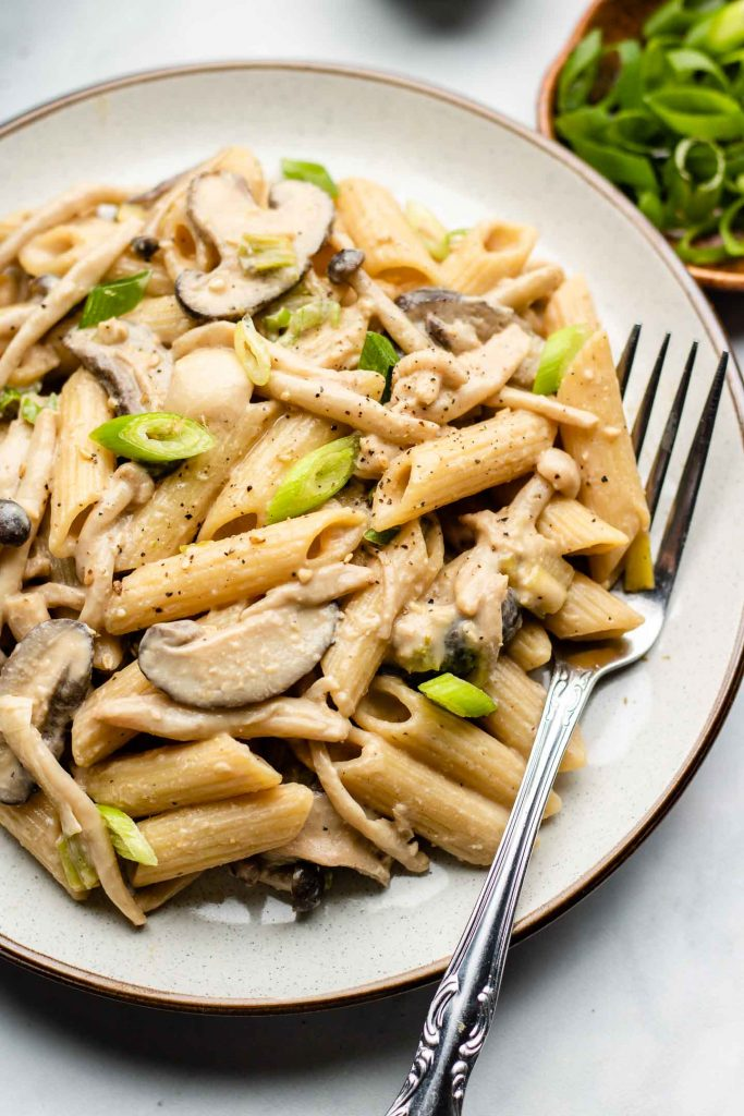 close up shot of creamy vegan mushroom penne pasta