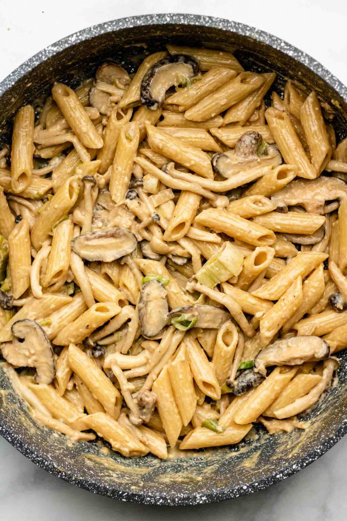 creamy penne pasta in one pot with tahini sauce and scallions