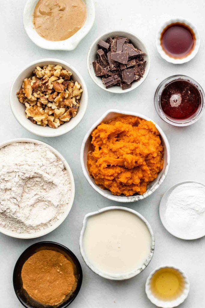 vegan pumpkin bread ingredients in white small bowls