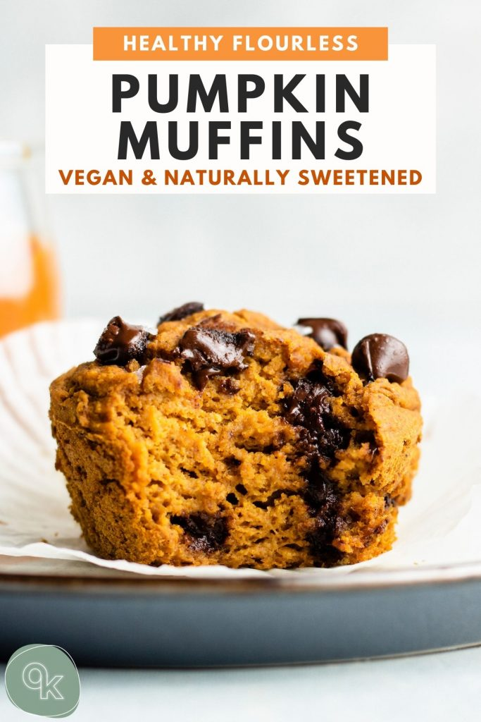 vegan pumpkin muffins on a white and blue plate with a bite taken out of it