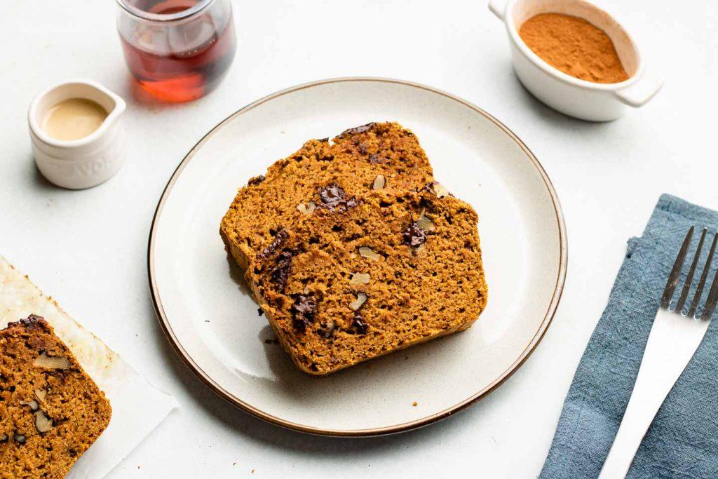 2 slices of chocolate walnut pumpkin bread on a white ceramic plate