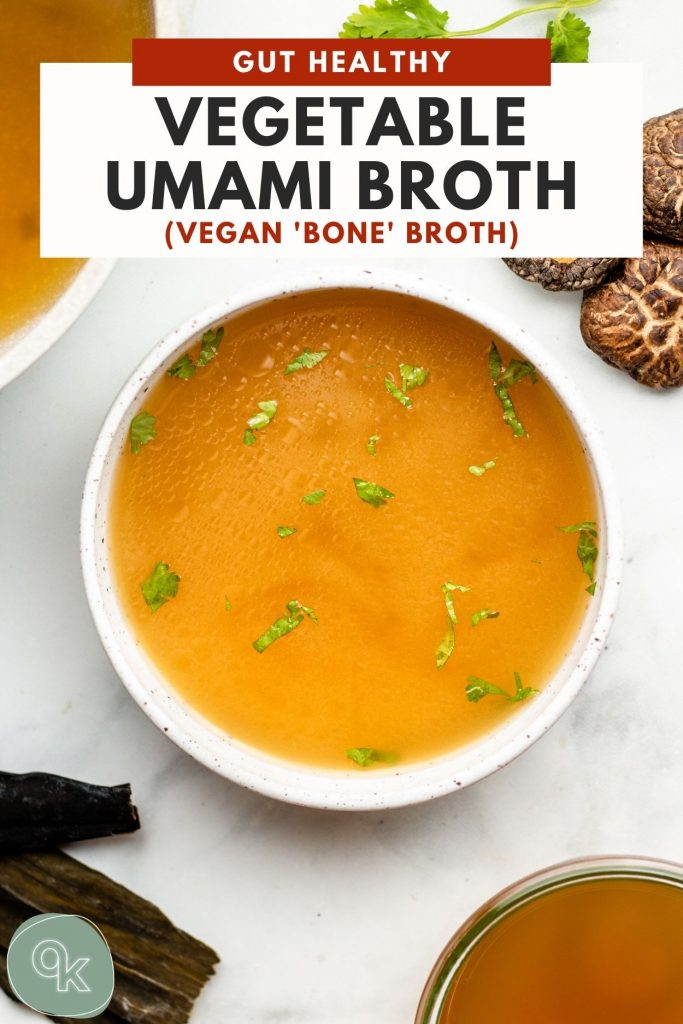 umami broth in a white bowl with miso and cilantro on a marble backdrop
