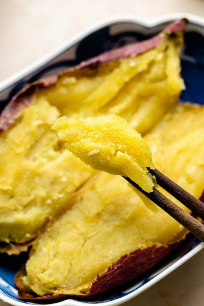 roasted japanese sweet potato picked up with chopsticks