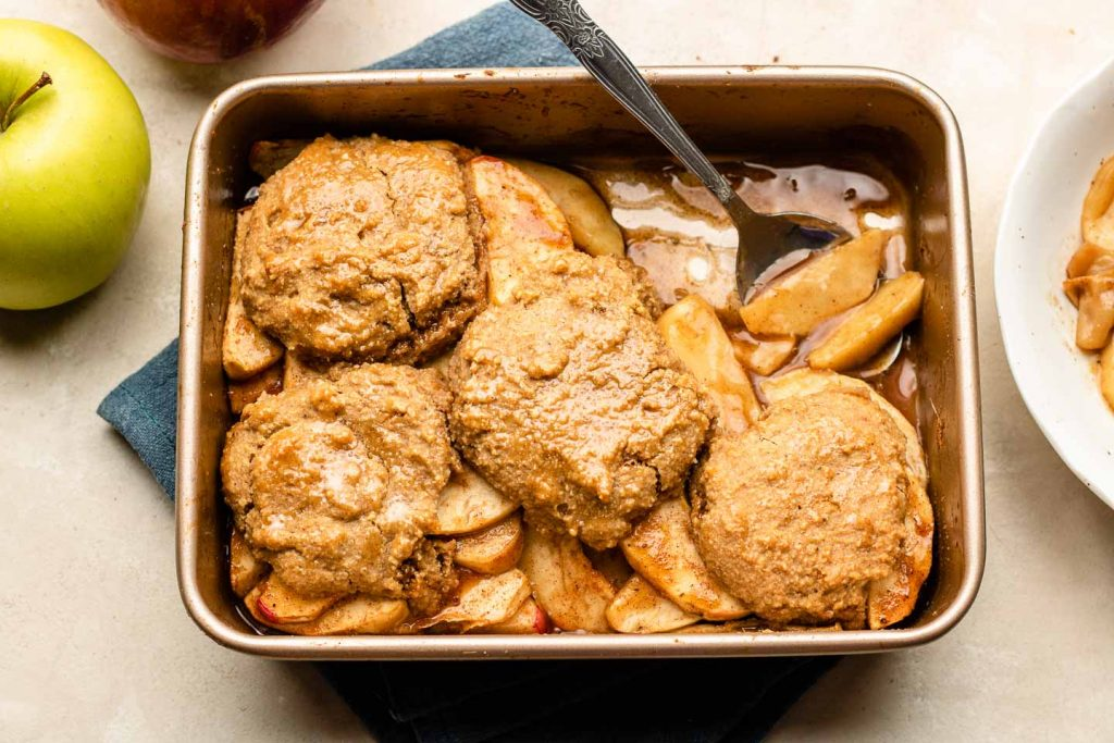 apple cobbler in a rose gold baking tray for biscuit topping