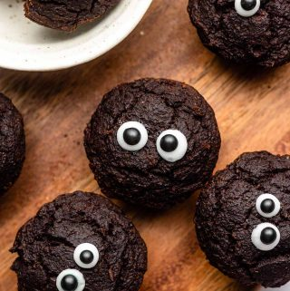 mini brownie bites with eyes on a cutting board