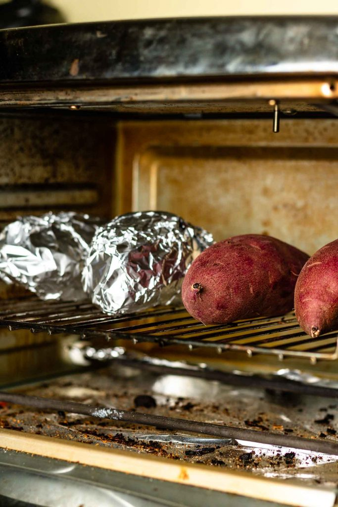 japanese sweet potatoes inside a mini oven on the wire rack