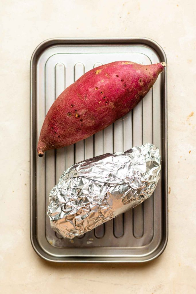 purple sweet potato on a baking tray one covered in foil