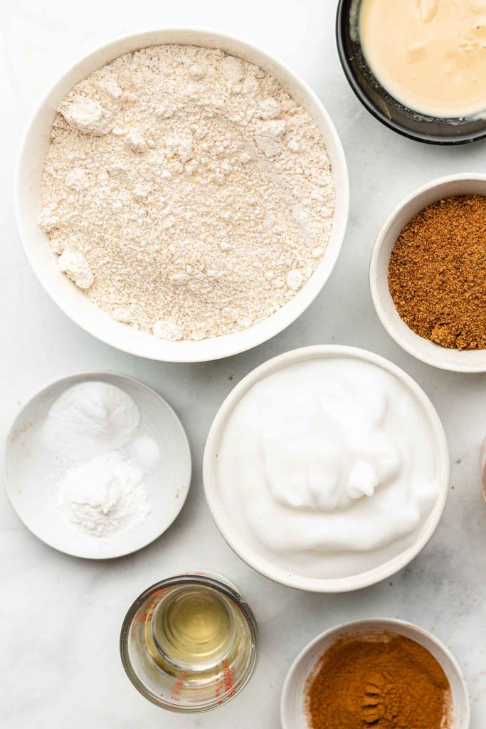 oat flour cinnamon roll ingredients in white bowls