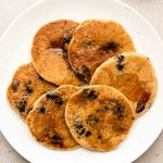 oat flour blueberry pancakes on a white plate