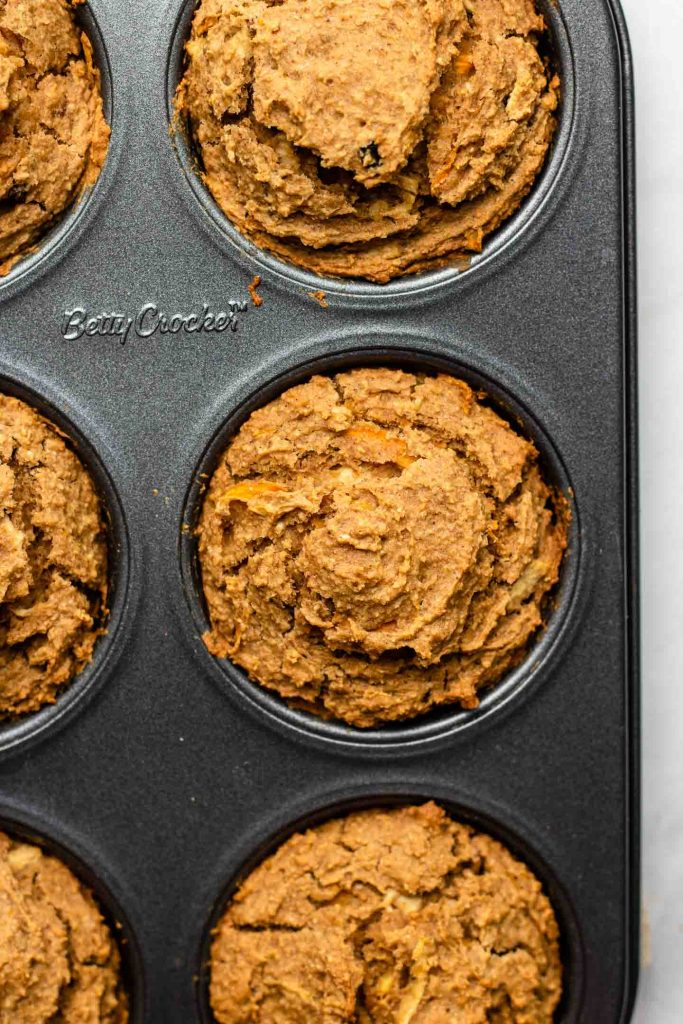 carrot apple muffins in a 6 cup muffin tin baked