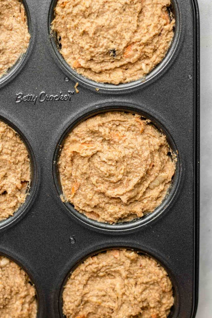 carrot apple muffin batter in a 6 cup muffin tin