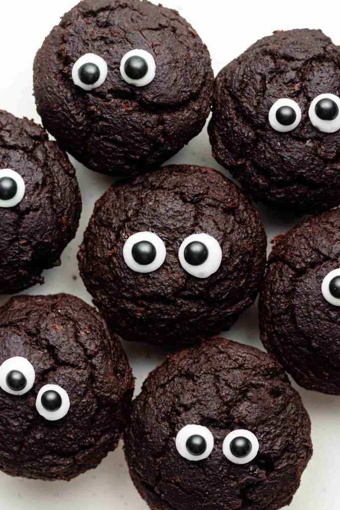 sweet potato brownie bites on a white plate with eyes