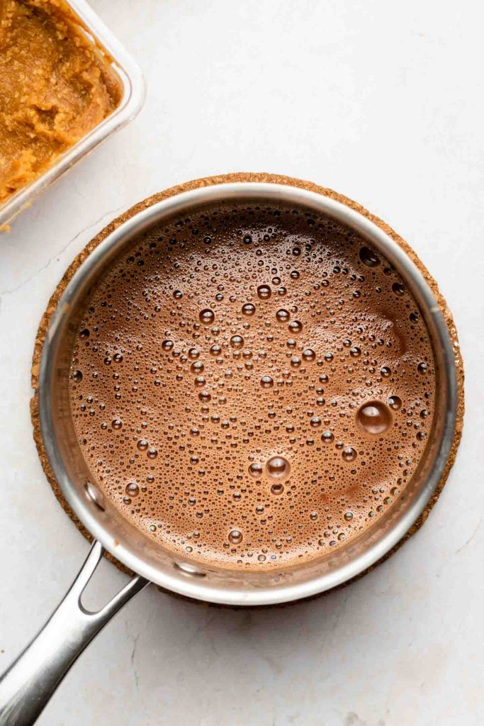 oat milk hot chocolate in a sauce pan