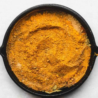 japanese curry powder spices in a cast iron skillet