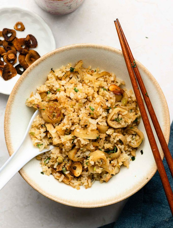 japanese garlic fried rice in a white bowl with gyoza