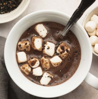 oat milk hot chocolate in a mug with marshmallows