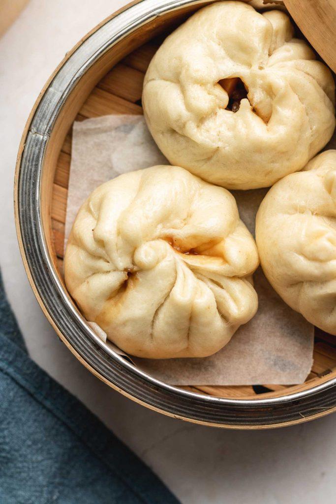vegan steamed chinese BBQ pork buns in a steamer basket