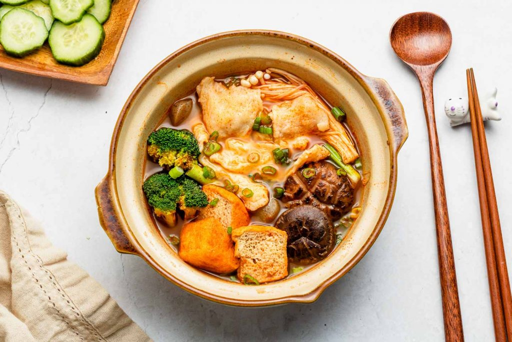hot and spicy noodle soup with vegetables and fresh noodles in a donabe