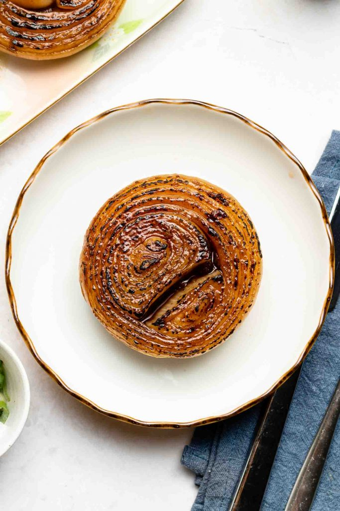 onion steak on a white small plate