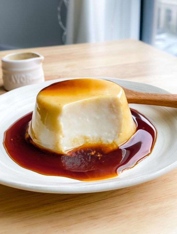 vegan purin on a white plate with caramel sauce