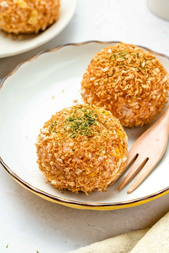 rice croquette on a white plate with parsley on top