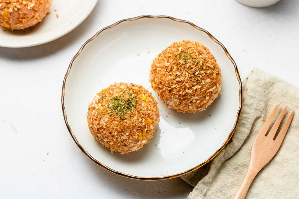 rice korokke (croquette) on a white plate with parsley on top
