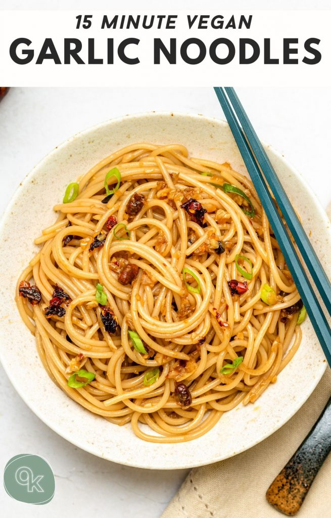 garlic noodles in a white bowl with blue chopsticks